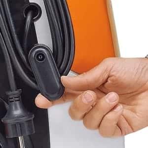 Rotating power cord holder